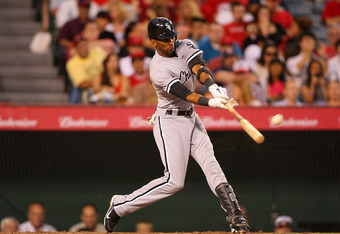 ANAHEIM, CA - AUGUST 24:  Alexei Ramirez #10 of the Chicago White Sox hits a single in the first inning against the Los Angeles Angels of Anaheim during the MLB game at Angel Stadium of Anaheim on August 24, 2011 in Anaheim, California.  (Photo by Victor