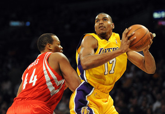 LOS ANGELES, CA - JANUARY 05:  Andrew Bynum #17 of the Los Angeles Lakers spins to score on Chuck Hayes #44 of the Houston Rockets during the first half at Staples Center on January 5, 2010 in Los Angeles, California.  NOTE TO USER: User expressly acknowl