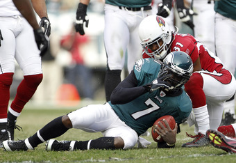 PHILADELPHIA, PA - NOVEMBER 13: Michael Vick #7 of the Philadelphia Eagles is tackled by Richard Marshall #31 of the Arizona Cardinals during a game at Lincoln Financial Field on November 13, 2011 in Philadelphia, Pennsylvania. The Cardinals defeated the
