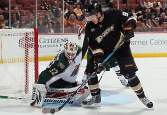 ANAHEIM, CA - NOVEMBER 13:  Bobby Ryan #9 of the Anaheim Ducks stick handles the puck as goaltender Niklas Backstrom #32 of the Minnesota Wild defends his net in the third period at Honda Center on November 13, 2011 in Anaheim, California. The Wild defeat