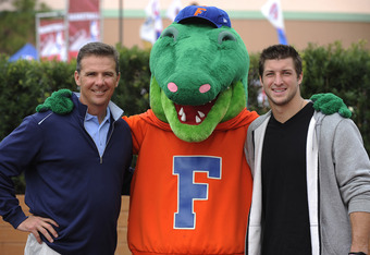 LAKE BUENA VISTA, FL - MARCH 05: (L-R) In this handout photo provided by Disney Parks, ESPN college football analyst and former University of Florida football coach, Urban Meyer, 'Albert' The University of Florida mascot and Denver Broncos Quarterback and
