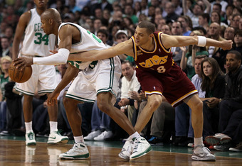 BOSTON - MAY 09:   Ray Allen #20 of the Boston Celtics is fouled by Anthony Parker #18 of the Cleveland Cavaliers during Game Four of the Eastern Conference Semifinals of the 2010 NBA playoffs at TD Garden on May 9, 2010 in Boston, Massachusetts. The Celt