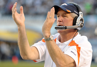 SAN DIEGO, CA - NOVEMBER 27:  Head coach John Fox of the Denver Broncos celebrates a play on the sidelines during the game against the San Diego Chargers Qualcomm Stadium on November 27, 2011 in San Diego, California.  The Broncos won 16-13.  (Photo by Ha
