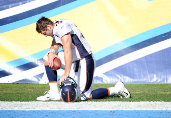 SAN DIEGO, CA - NOVEMBER 27:   Tim Tebow #15 of the Denver Broncos prays before the game against the San Diego Chargers at Qualcomm Stadium on November 27, 2011 in San Diego, California.  The Broncos went on to win 16-13 in overtime.   (Photo by Harry How