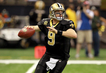 NEW ORLEANS, LA - NOVEMBER 28:  Quarterback  Drew Brees #9 of the New Orleans Saints drops back to pass in the first quarter against the New York Giants at Mercedes-Benz Superdome on November 28, 2011 in New Orleans, Louisiana.  (Photo by Ronald Martinez/