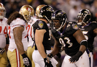 BALTIMORE, MD - NOVEMBER 24:  Cory Redding #93 of the Baltimore Ravens celebrates after sacking  Alex Smith #11 of the San Francisco 49ers during the first half at M&T Bank Stadium on November 24, 2011 in Baltimore, Maryland.  (Photo by Rob Carr/Getty Ima