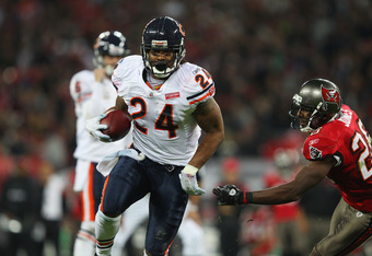 LONDON, ENGLAND - OCTOBER 23:  Marion Barber #24 of the Chicago Bears beats Sean Jones #26 of the Tampa Bay Buccaneers to score a touchdown during the NFL International Series match between Chicago Bears and Tampa Bay Buccaneers at Wembley Stadium on Octo