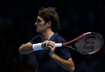 LONDON, ENGLAND - NOVEMBER 22:  Roger Federer of Switzerland returns the ball during the men's singles match against Rafael Nadal of Spain during the Barclays ATP World Tour Finals at the O2 Arena on November 22, 2011 in London, England.  (Photo by Clive