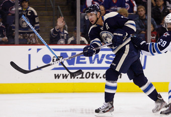 COLUMBUS, OH - NOVEMBER 12:  Jeff Carter #7 of the Columbus Blue Jackets takes a shot on goal during the game against the Winnipeg Jets at Nationwide Arena on November 12, 2011 in Columbus, Ohio.  (Photo by John Grieshop/Getty Images)