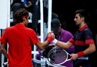 LONDON, ENGLAND - NOVEMBER 27:  Roger Federer of Switzerland (L) shakes hands with Novak Djokovic of Serbia (R) after winning his men's semi-final match during the ATP World Tour Finals at O2 Arena on November 27, 2010 in London, England.  (Photo by Clive