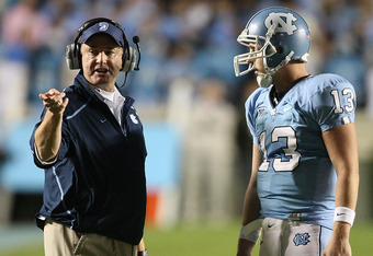 CHAPEL HILL, NC - NOVEMBER 07:  Head coach Butch Davis (L) stands with his quarterback T.J. Yates #13 of the North Carolina Tar Heels during their game against the Duke Blue Devilsat Kenan Stadium on November 7, 2009 in Chapel Hill, North Carolina.  (Phot