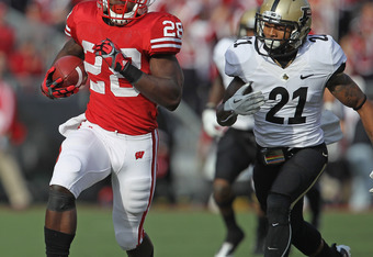 MADISON, WI - NOVEMBER 05: Montee Ball #28 of the Wisconsin Badgers breaks a long run in the first quarter as Ricardo Allen #21 of the Purdue Boilermakers pursues at Camp Randall Stadium on November 5, 2011 in Madison Wisconsin. (Photo by Jonathan Daniel/