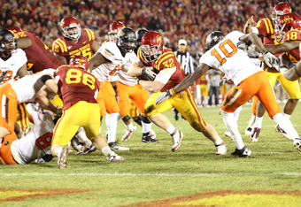 AMES, IA - NOVEMBER 18:  Jeff Woody #32 of the Iowa State Cyclones scores the winning touchdown in overtime against the Oklahoma State Cowboys at Jack Trice Stadium November 18, 2011 in Ames, Iowa.  The Cyclones beat the Cowboys 37-31.  (Photo by Reese St