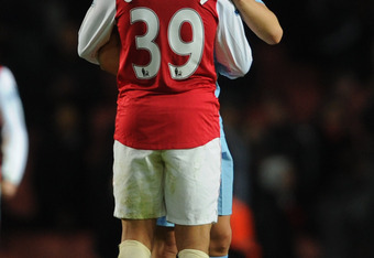 LONDON, ENGLAND - NOVEMBER 29:  Samir Nasri of Manchester City and Francis Coquelin of Arsenal embrace after the Carling Cup Quarter Final match between Arsenal and Manchester City at Emirates Stadium on November 29, 2011 in London, England.  (Photo by Mi