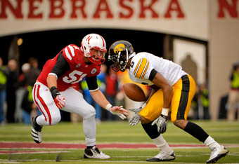 LINCOLN, NE - NOVEMBER 25: Linebacker Will Compton #51 of the Nebraska Cornhuskers draws a bead on wide receiver Keenan Davis #6 of the Iowa Hawkeyes during their game at Memorial Stadium November 25, 2011 in Lincoln, Nebraska. Nebraska defeated Iowa 20-7