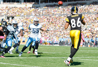 PITTSBURGH, PA - OCTOBER 09:  Hines Ward #86 of the Pittsburgh Steelers catches a touchdown pass against the Tennessee Titans during the game on October 9, 2011 at Heinz Field in Pittsburgh, Pennsylvania.  (Photo by Jared Wickerham/Getty Images)