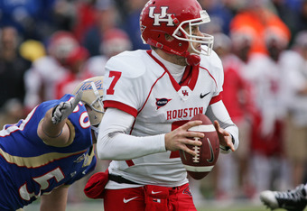 TULSA, OK - NOVEMBER 25:  Quarterback Case Keenum #7 of the Houston Cougars looks to throw in the second half against the Tulsa Hurricanes November 25, 2011 at H.A. Chapman Stadium in Tulsa, Oklahoma.  Houston defeated Tulsa 48-16.  (Photo by Brett Deerin