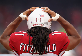 SAN FRANCISCO, CA - NOVEMBER 20:  Larry Fitzgerald #11 of the Arizona Cardinals stands on the sidelines before their game against the San Francisco 49ers at Candlestick Park on November 20, 2011 in San Francisco, California.  (Photo by Ezra Shaw/Getty Ima