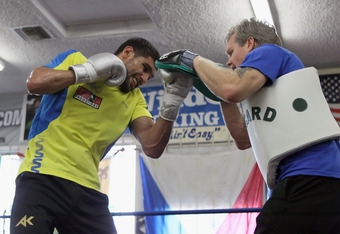 HOLLYWOOD, CA - NOVEMBER 15:  Amir Khan (L) of England and trainer Freddie Roach spar at the Wild Card Boxing Club ahead of Khan's world title defense against Lamont Peterson on November 15, 2011 in Hollywood, California.  (Photo by Jeff Gross/Getty Image