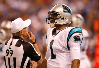 INDIANAPOLIS, IN - NOVEMBER 27 Cam Newton #1 of the Carolina Panthers talks with referee Terry Corrente #99 during the game against the Indianapolis Colts at Lucas Oil Stadium on November 27, 2011 in Indianapolis, Indiana. (Photo by Scott Boehm/Getty Imag