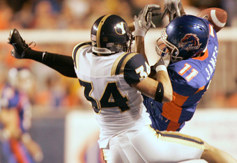 BOISE, ID - SEPTEMBER 24:  Brandon Heaney #34 of BYU breaks up a pass to Drisan James #11 of Boise State September 29, 2004 at Broncos Stadium in Boise, Idaho.  (Photo by George Frey/Getty Images)
