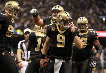 NEW ORLEANS, LA - NOVEMBER 28:  Drew Brees #9 of the New Orleans Saints celebrates his touchdown against the New York Giants at Mercedes-Benz Superdome on November 28, 2011 in New Orleans, Louisiana.  (Photo by Ronald Martinez/Getty Images)