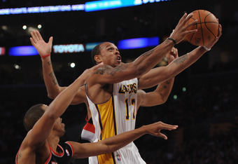 LOS ANGELES, CA - NOVEMBER 07:  Shannon Brown #12 of the Los Angeles Lakers goes in for a layup in front of Andre Miller #24 of the Portland Trail Blazers during the first half at the Staples Center on November 7, 2010 in Los Angeles, California.  NOTE TO