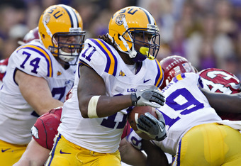 BATON ROUGE, LA - NOVEMBER 25:   Spencer Ware #11 of the LSU Tigers runs the ball against the Arkansas Razorbacks at Tiger Stadium on November 25, 2011 in Baton Rouge, Louisiana.  The Tigers defeated the Razorbacks 41 to 17.  (Photo by Wesley Hitt/Getty I