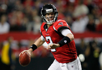 ATLANTA, GA - NOVEMBER 27:  Matt Ryan #2 of the Atlanta Falcons rolls out of the pocket against the Minnesota Vikings at Georgia Dome on November 27, 2011 in Atlanta, Georgia.  (Photo by Kevin C. Cox/Getty Images)