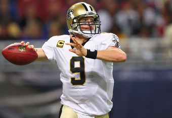 ST. LOUIS, MO - OCTOBER 30: Drew Brees #9 of the New Orleans Saints passes against the St. Louis Rams at the Edward Jones Dome on October 30, 2011 in St. Louis, Missouri.  The Rams beat the Saints 31-21.  (Photo by Dilip Vishwanat/Getty Images)