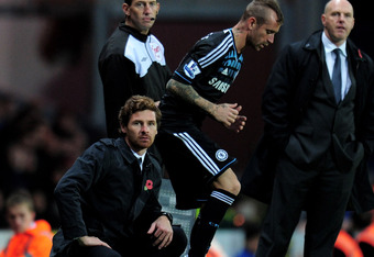 BLACKBURN, ENGLAND - NOVEMBER 05:  Chelsea Manager Andre Villas Boas looks on as Raul Meireles prepares to come on as a substitute during the Barclays Premier League match between Blackburn Rovers and Chelsea at Ewood Park on November 5, 2011 in Blackburn