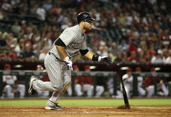 PHOENIX, AZ - AUGUST 30:  Chris Iannetta #20 of the Colorado Rockies hits a RBI single against the Arizona Diamondbacks during the fourth inning of the Major League Baseball game at Chase Field on August 30, 2011 in Phoenix, Arizona.  (Photo by Christian