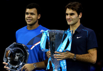 LONDON, ENGLAND - NOVEMBER 27:  Roger Federer of Switzerland poses next to Jo-Wilfried Tsonga of France after Federer won the men's final singles match against during the Barclays ATP World Tour Finals at the O2 Arena on November 27, 2011 in London, Engla