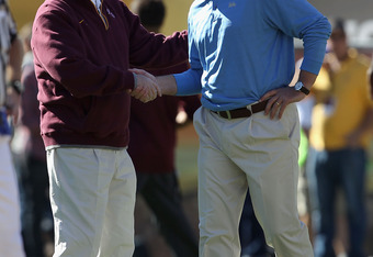 ASU head coach Dennis Erickson (left) and UCLA head coach Rick Neuheisel (right) were both fired Monday after losing seasons.