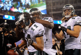 EAST RUTHERFORD, NJ - NOVEMBER 20:  (L-R) Steve Smith #11, Jason Avant #81 and Riley Cooper #14 of the Philadelphia Eagles celebrate after Smith scored a 14-yard touchdown catch in the second quarter against the New York Giants at MetLife Stadium on Novem
