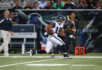 ST. LOUIS, MO - NOVEMBER 20: Doug Baldwin #15 of the Seattle Seahawks runs against the St. Louis Rams at the Edward Jones Dome on November 20, 2011 in St. Louis, Missouri.  (Photo by Dilip Vishwanat/Getty Images)