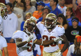 GAINESVILLE, FL - NOVEMBER 26:  Cornerback Greg Reid #5 of the Florida State Seminoles celebrates a first quarter interception against the Florida Gators November 26, 2011 at Ben Hill Griffin Stadium in Gainesville, Florida.  (Photo by Al Messerschmidt/Ge