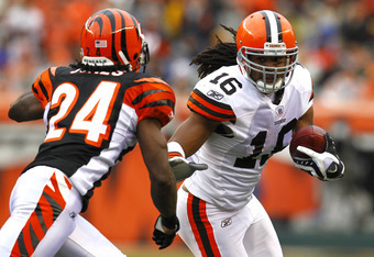 CINCINNATI, OH - NOVEMBER 27:  Joshua Cribbs #16 of the Cleveland Browns looks to run past around Adam Jones #24 of the Cincinnati Bengals at Paul Brown Stadium on November 27, 2011 in Cincinnati, Ohio.  (Photo by Tyler Barrick/Getty Images)