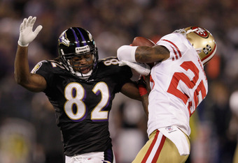 BALTIMORE, MD - NOVEMBER 24:  Tarell Brown #25 of the San Francisco 49ers intercepts a pass intended for  Torrey Smith #82 of the Baltimore Ravens during the first half at M&T Bank Stadium on November 24, 2011 in Baltimore, Maryland. Brown was called for