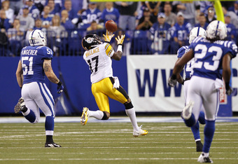 INDIANAPOLIS, IN - SEPTEMBER 25: Mike Wallace #17 of the Pittsburgh Steelers hauls in an 81-yard touchdown pass in the first half against the Indianapolis Colts at Lucas Oil Stadium on September 25, 2011 in Indianapolis, Indiana. (Photo by Joe Robbins/Get