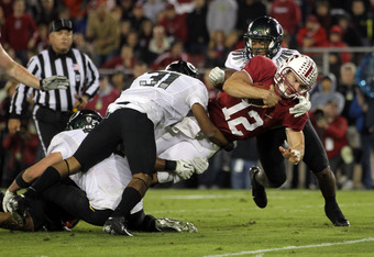 STANFORD, CA - NOVEMBER 12:  Andrew Luck #12 of the Stanford Cardinal is stopped just short of the goal line by the Oregon Ducks defense at Stanford Stadium on November 12, 2011 in Stanford, California.  (Photo by Ezra Shaw/Getty Images)