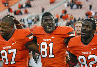 STILLWATER, OK - OCTOBER 29:  Wide receiver Justin Blackmon #81, inside receiver Tracy Moore #87 and wide receiver Isaiah Anderson #82 of the Oklahoma State Cowboys sing the school song to fans after the game against the Baylor Bears on October 29, 2011 a