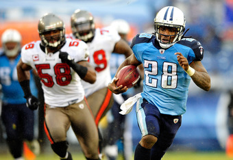 NASHVILLE, TN - NOVEMBER 27:  Chris Johnson #28 of the Tennessee Titans breaks away from Quincy Black #58 and John McCargo #79 of the Tampa Bay Buccaneers for a long gain during play at LP Field on November 27, 2011 in Nashville, Tennessee. The Titans won
