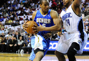 ORLANDO, FL - MARCH 28:  Aaron Affalo #6 of the Denver Nuggets attempts to drive against Jameer Nelson #14 of the Orlando Magic during the game at Amway Arena on March 28, 2010 in Orlando, Florida.  NOTE TO USER: User expressly acknowledges and agrees tha