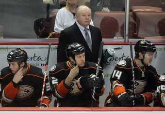 ANAHEIM, CA - DECEMBER 02:  Anaheim Ducks head coach Bruce Boudreau looks on from behind the bench during the game against the Philadelphia Flyers at Honda Center on December 2, 2011 in Anaheim, California.  (Photo by Jeff Gross/Getty Images)