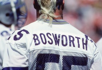 DENVER, CO - SEPTEMBER 13:  Linebacker Brian Bosworth #55 of the Seattle Seahawks looks on from the sideline during the game against the Denver Broncos at Mile High Staduim on September 13, 1987 in Denver, Colorado.  The Broncos won 40-17. (Photo by Georg