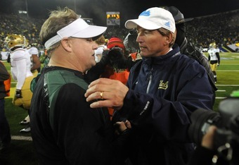 EUGENE, OR - DECEMBER 02 : Head coach Chip Kelly of the Oregon Ducks and head coach Rick Neuheisel of the UCLA Bruins shake hands at the end of the Pac-12 Championship game at Autzen Stadium on December 2, 2011 in Eugene, Oregon. The Ducks won the game 49