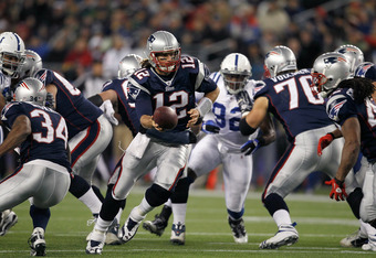 FOXBORO, MA - NOVEMBER 21: Tom Brady #12 of the New England Patriots hands the ball to BenJarvus Green-Ellis #42 in the second half at Gillette Stadium on November 21, 2010 in Foxboro, Massachusetts. (Photo by Jim Rogash/Getty Images)