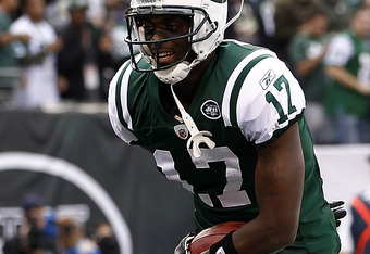 EAST RUTHERFORD, NJ - NOVEMBER 27:  Plaxico Burress #17 of the New York Jets celebrates against the Buffalo Bills during their game at MetLife Stadium on November 27, 2011 in East Rutherford, New Jersey.  (Photo by Jeff Zelevansky/Getty Images)