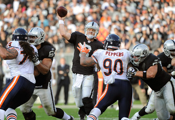 OAKLAND, CA - NOVEMBER 27:  Carson Palmer #3 of the Oakland Raiders throws a pass presured by Julius Peppers #90 of the Chicago Bears at O.co Coliseum on November 27, 2011 in Oakland, California.  (Photo by Thearon W. Henderson/Getty Images)